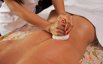 Thai herbal hot massage